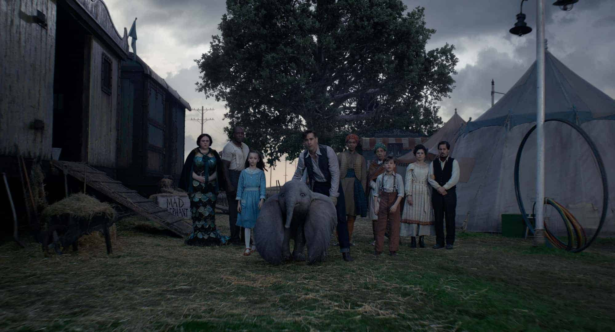 "FAMILY TIES – In Tim Burton's all-new, live-action reimagining of ""Dumbo,"" Holt Farrier (Colin Farrell), with the help of his children Milly (Nico Parker) and Joe (Finley Hobbins), is called on to take care of a newborn elephant whose oversized ears make him a laughingstock in an already struggling circus. Holt's circus family includes Miss Atlantis (Sharon Rooney), Rongo (DeObia Oparei), Pramesh's nephew (Ragevan Vasan), Pramesh Singh (Roshan Seth), Catherine the Greater (Zenaida Alcalde) and Ivan the Wonderful (Miguel Muñoz). ""Dumbo"" opens in theaters on March 29, 2019. © 2018 Disney Enterprises, Inc. All Rights Reserved."