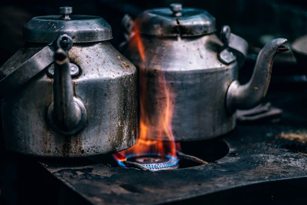 How to Arrange Your Kitchen Around a Wood-Burning Stove