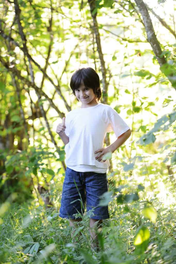 Kid standing in nature